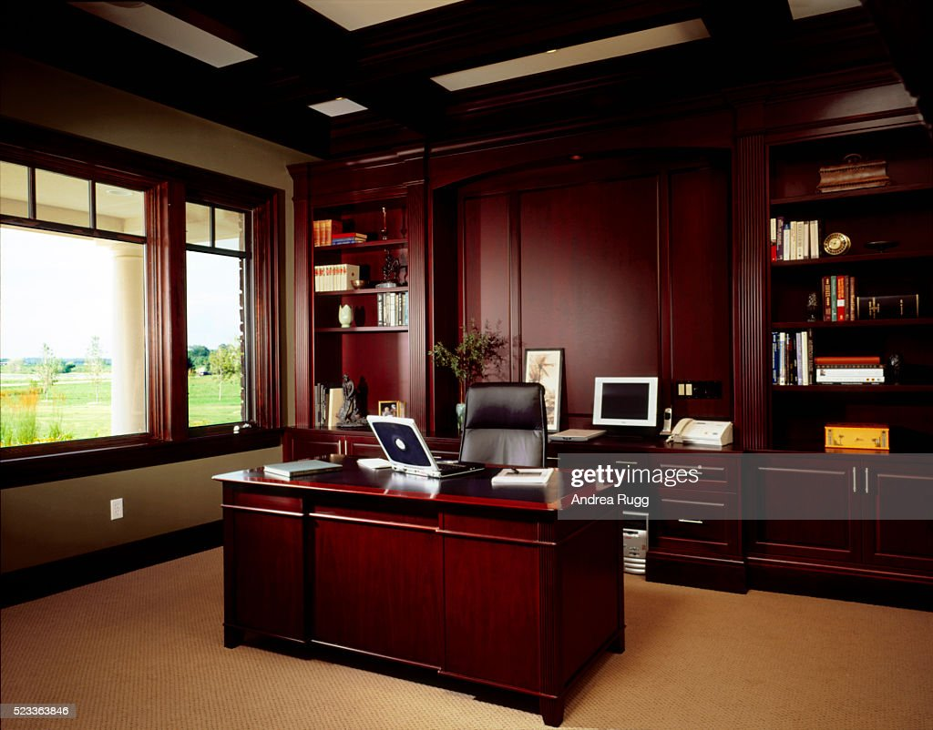 Home Office With Dark Wood Panel Walls : Stock Photo