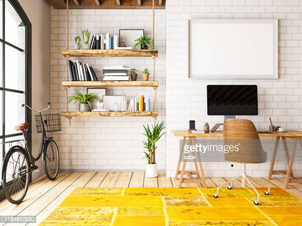 home office with workplace and bicycle - home office stock pictures, royalty-free photos & images