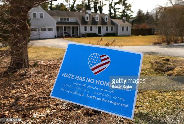 """Home on a front lawn reads """"Hate Has No Home Here"""" in Duxbury, MA, on March 24, 2021. The Town of Duxbury is in the limelight after Duxbury High..."""