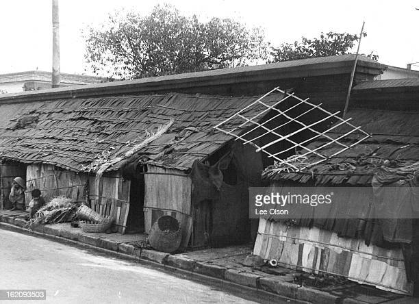 FEB 13 1961 Home on the Sidewalks This was a Calcutta sidewalk until Hindu refugees forced from East Pakistan after the partition of 1947...