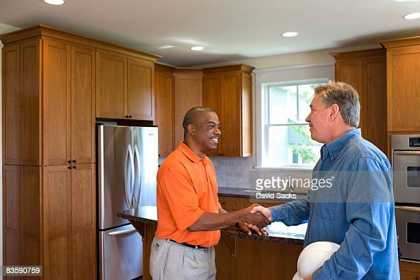 Home owner talking with contractor