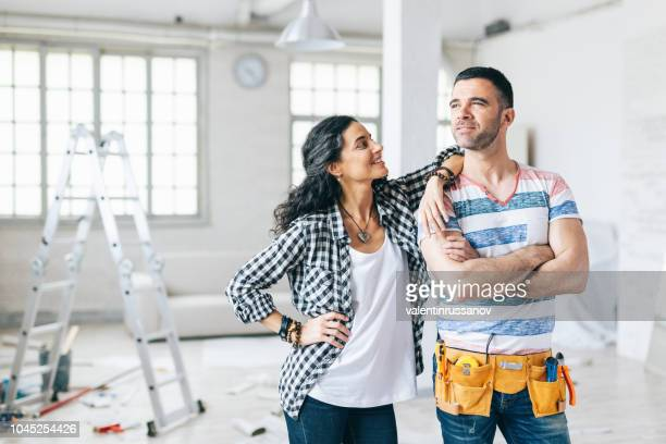 home owners in their new apartment - home improvement stock pictures, royalty-free photos & images