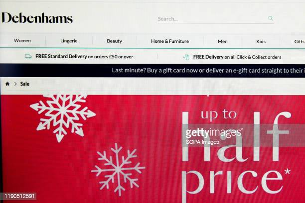 Home page of Debenhams is seen on a computer as online Boxing Day sales starts.