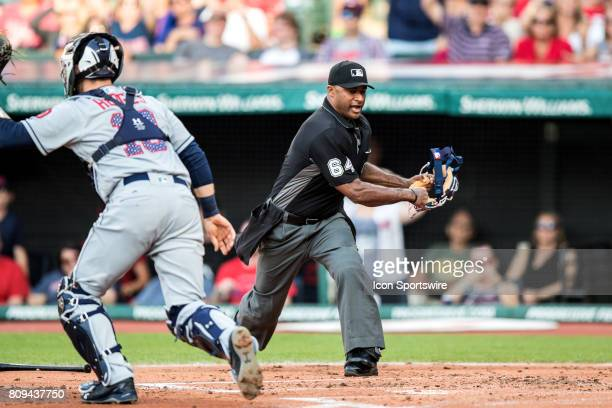 Home plate umpire Alan Porter calls Cleveland Indians third baseman Jose Ramirez out at home plate during the second inning of the Major League...
