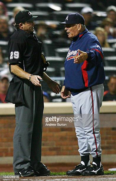 Home plate umpire Bill Hohn argues with Bobby Cox of the Atlanta Braves during a game against the New York Mets on September 17 2010 at Citi Field in...
