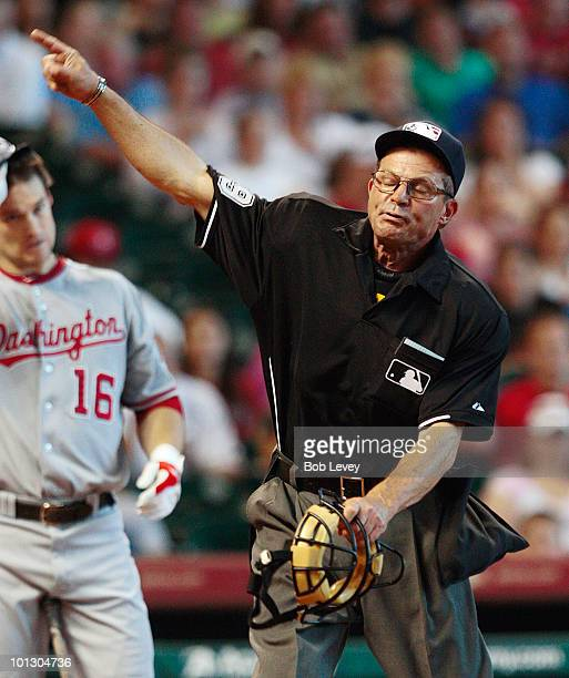 Home plate umpire Bill Hohn throws pitcher Roy Oswalt of the Houston Astros out of the game in the third inning for complaining about the strike zone...
