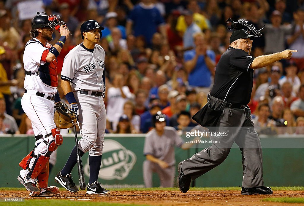 Home plate umpire Brian O'Nora warns both benches after Alex Rodriguez #13 of the New York Yankees was hit by a pitch in front of Jarrod Saltalamacchia #39 of the Boston Red Sox in the 2nd inning during the game on August 18, 2013 at Fenway Park in Boston, Massachusetts.