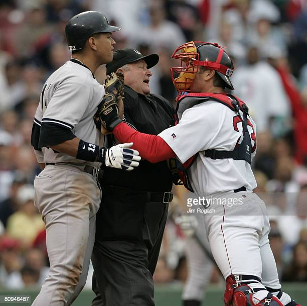 Home plate umpire Bruce Froemming attempts to keep Boston Red Sox catcher Jason Varitek right away New York Yankees batter Alex Rodriguez in the...