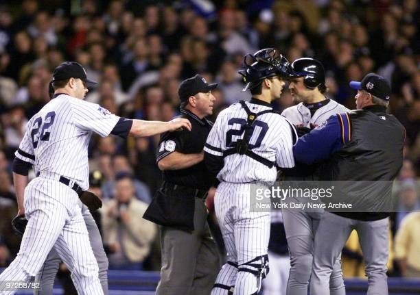Home plate umpire Charlie Reliford steps between New York Mets' Mike Piazza and New York Yankees' starting pitcher Roger Clemens as they argue after...
