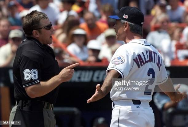 Home plate umpire Chris Guccione argues with New York Mets manager Bobby Valentine over a foul ball call on Florida Marlins shortstop Andy Fox in the...