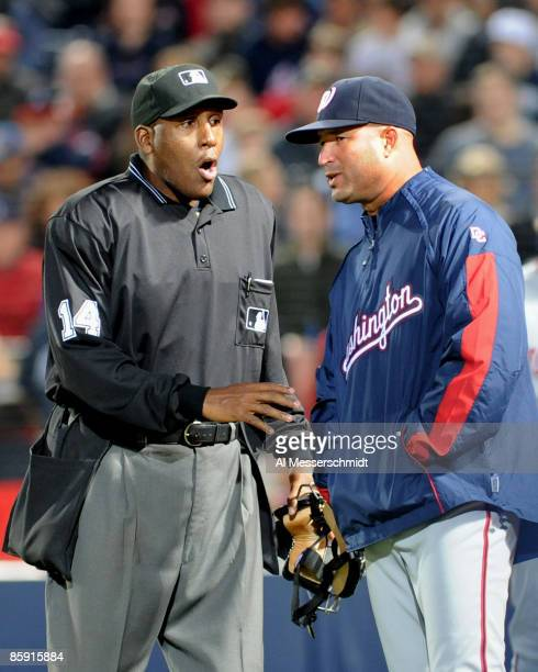 Home plate umpire Chuck Meriwether explains a call to manager Manny Acta of the Washington Nationals during play against the Atlanta Braves April 11...