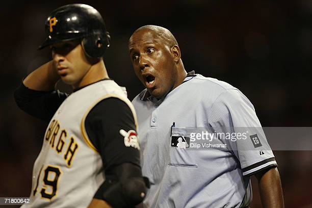 Home plate umpire Chuck Meriwether reacts during the Pittsburgh Pirates game against the St Louis Cardinals at Busch Stadium on September 2 2006 in...