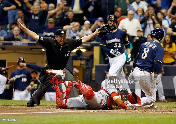 Home plate umpire Clint Fagan calls Ryan Braun of the Milwaukee Brewers safe after a tag attempt by Geovany Soto of the Los Angeles Angels of Anaheim...