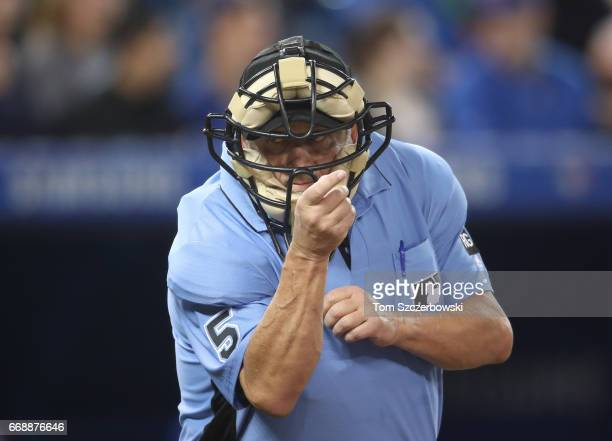 Home plate umpire Dale Scott calls a strike during the Toronto Blue Jays MLB game against the Baltimore Orioles at Rogers Centre on April 14 2017 in...