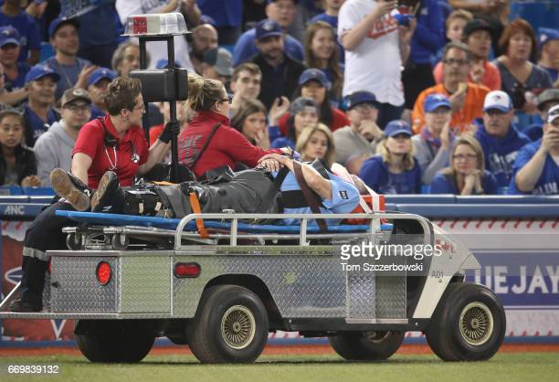 Home plate umpire Dale Scott is carted off the field on a stretcher by medical staff after being hit by a foul ball in the eighth inning of the...