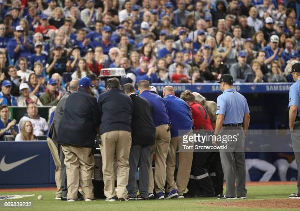 Home plate umpire Dale Scott is placed on a stretcher before being carted off the field after being hit by a foul ball in the eighth inning of the...