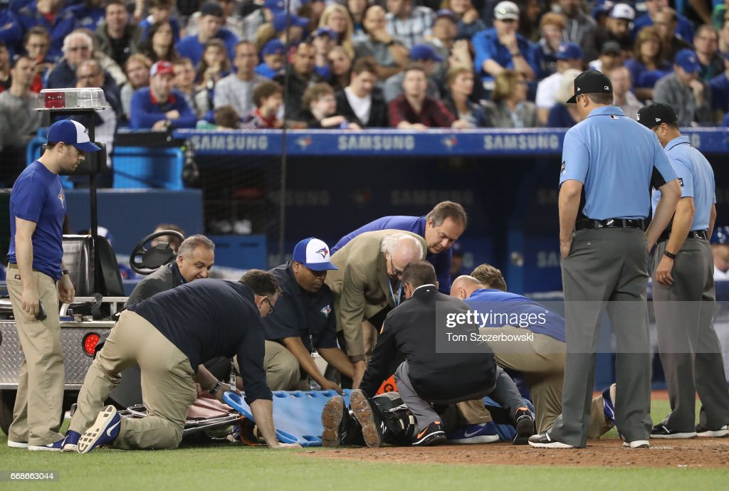 Home plate umpire Dale Scott #5 is taken out of the game on a stretcher after being hit by a foul ball in the eighth inning of the Toronto Blue Jays MLB game against the Baltimore Orioles at Rogers Centre on April 14, 2017 in Toronto, Canada.