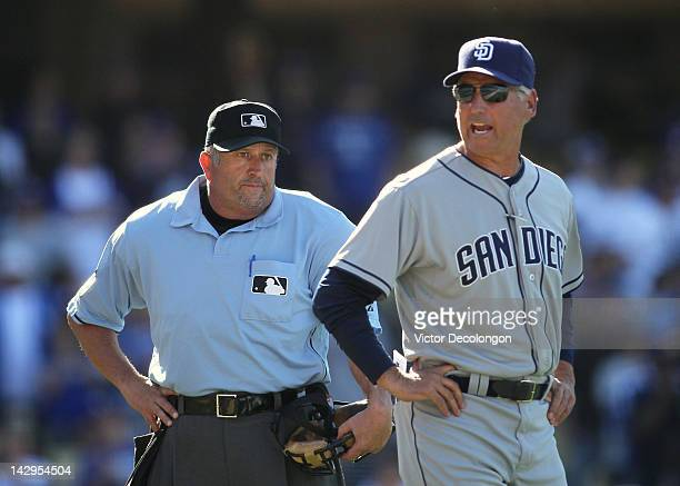 Home plate umpire Dale Scott looks on as Manager Bud Black of the San Diego Padres speaks his mind after a triple play in the ninth inning during the...