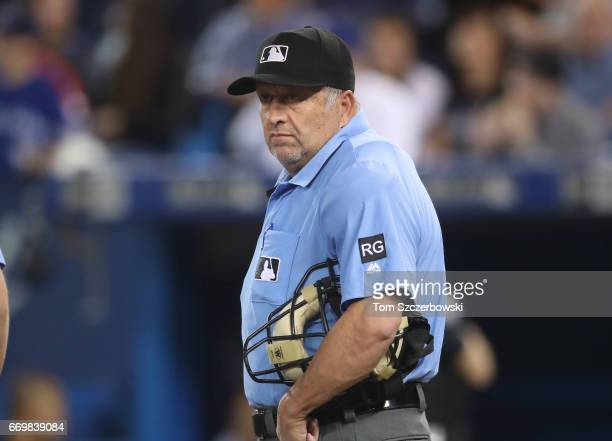Home plate umpire Dale Scott looks on during the Toronto Blue Jays MLB game against the Baltimore Orioles at Rogers Centre on April 14 2017 in...