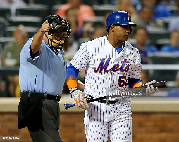 Home plate umpire Dale Scott sends Yoenis Cespedes of the New York Mets to first after he is hit by a pitch from Tom Koehler of the Miami Marlins in...