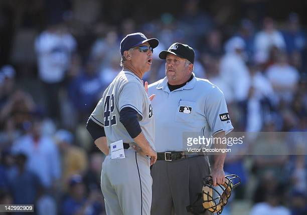 Home plate umpire Dale Scott speaks with Manager Bud Black of the San Diego Padres after a triple play in the ninth inning during the MLB game...