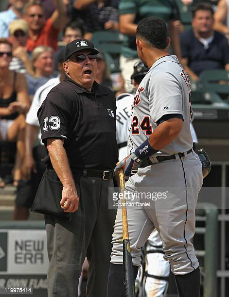 Home plate umpire Derryl Cousins yells at Miguel Cabrera of the Detroit Tigers after Cabrera began arguing about being called out on strikes against...