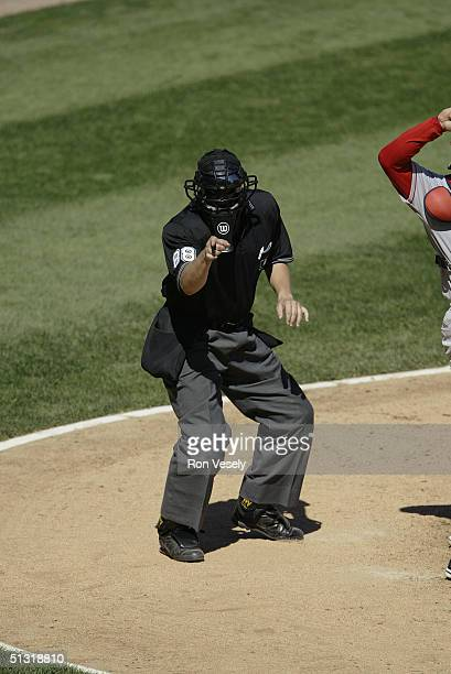 Home plate umpire Doug Eddings calls a strike during the game between the Boston Red Sox and the Chicago White Sox at US Cellular Field on August 21...