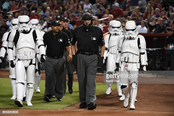 Home plate umpire Gary Cederstrom is escorted to home plate by Stormtroopers prior to a game between the Arizona Diamondbacks and the Philadelphia...