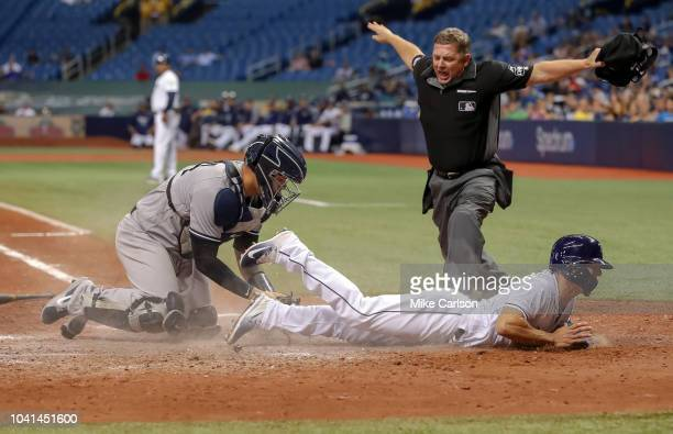 Home plate umpire Greg Gibson calles Andrew Velazquez of the Tampa Bay Rays safe ahead of a tag from Gary Sanchez of the New York Yankees in the...