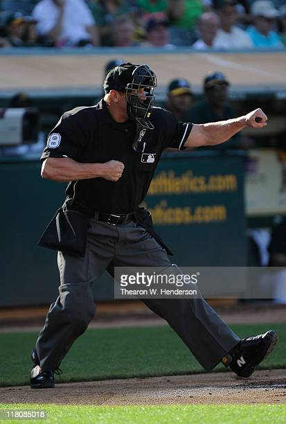 Home Plate umpire Jeff Kellogg calls strike three and punches out Justin Upton of the Arizona Diamondbacks against the Oakland Athletics during a MLB...