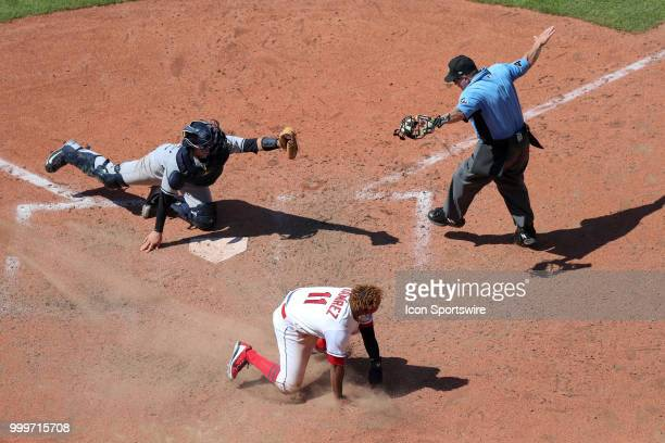 Home plate umpire Jerry Meals signals Cleveland Indians third baseman Jose Ramirez safe at home ahead of the tag of New York Yankees catcher Kyle...