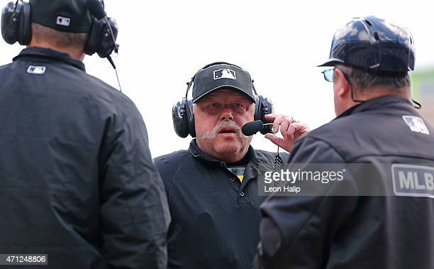 Home plate umpire Jim Joyce checks with the video replay crew during a second inning challenge by the Cleveland Indians on April 26 2015 at Comerica...