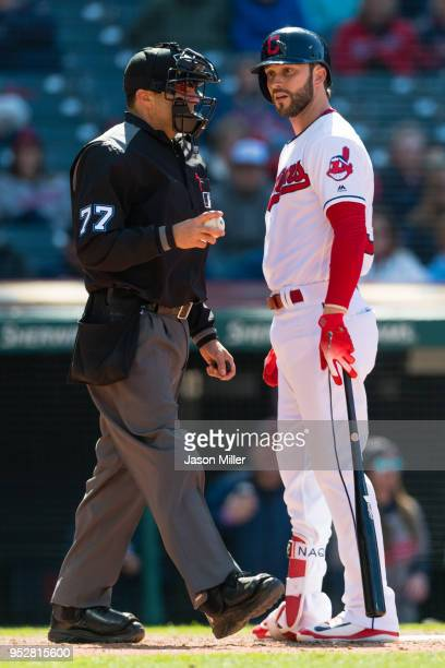Home plate umpire Jim Reynolds listens to Tyler Naquin of the Cleveland Indians argue a call after Naquin struck out to end the eighth inning against...