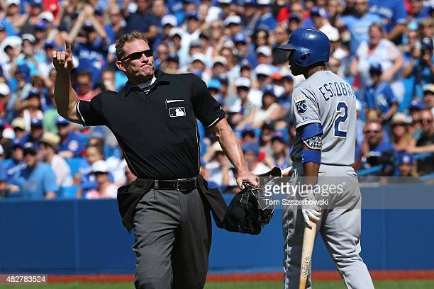 Home plate umpire Jim Wolf ejects Aaron Sanchez of the Toronto Blue Jays after hitting Alcides Escobar of the Kansas City Royals in the eighth inning...