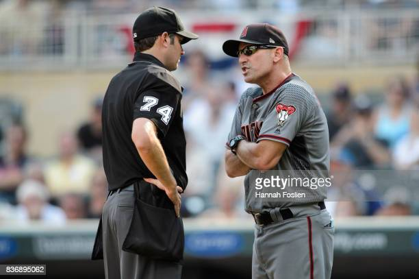 Home plate umpire John Tumpane and manager Torey Lovullo of the Arizona Diamondbacks argue during the game against the Minnesota Twins on August 20...