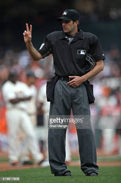 Home plate umpire John Tumpane signals for baseballs during the game between the Los Angeles Dodgers and the San Francisco Giants at ATT Park on...