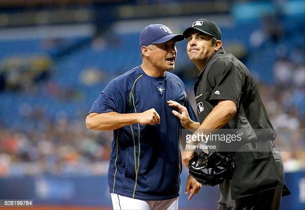 Home plate umpire Mark Ripperger ejects manager Kevin Cash of the Tampa Bay Rays from the game during the fifth inning of a game against the Toronto...