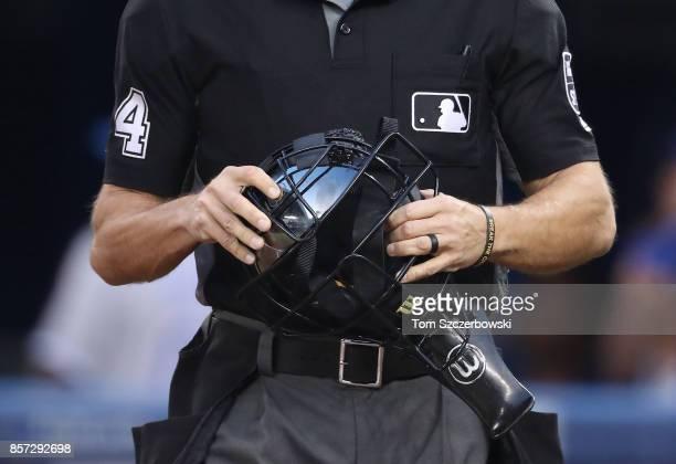 Home plate umpire Mark Wegner holds his mask during the Toronto Blue Jays MLB game against the Kansas City Royals at Rogers Centre on September 20...
