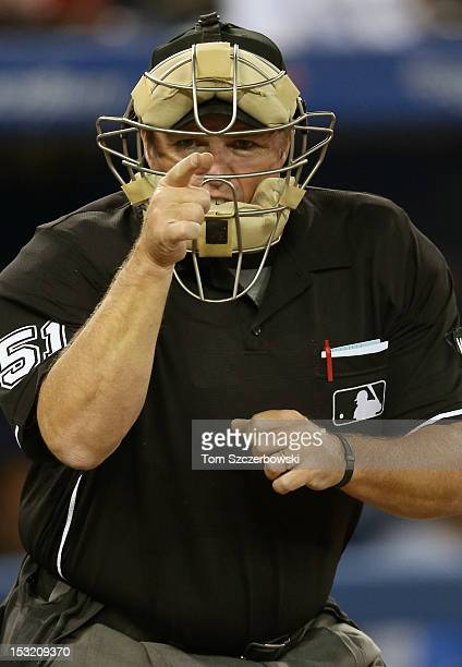 Home plate umpire Marvin Hudson calls a strike during the Toronto Blue Jays MLB game against the Minnesota Twins on October 1, 2012 at Rogers Centre...