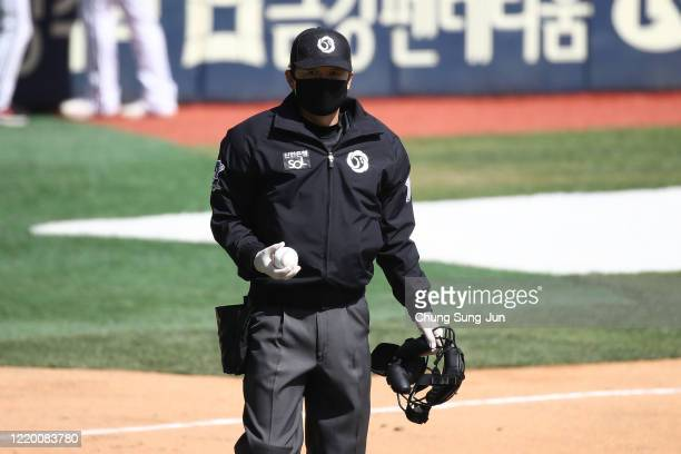 Home plate umpire Oh Hoongyu wear a m during the preseason game between LG Twins and Doosan Bears at Jamsil Baseball Stadium on April 21 2020 in...