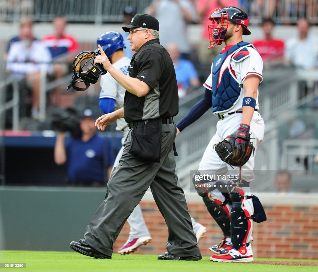 Home Plate Umpire Paul Emmel issues a warning to the Atlanta Braves after Julio Teheran (not pictured) hit Jose Bautista #19 of the Toronto Blue Jays with a first inning pitch as Catcher Tyler Flowers watches at SunTrust Park on May 18, 2017 in Atlanta, Georgia.