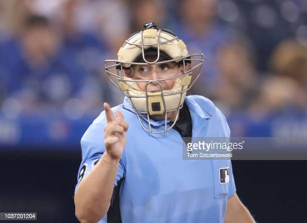 Home plate umpire Quinn Wolcott calls a strike during the Toronto Blue Jays MLB game against the Tampa Bay Rays at Rogers Centre on September 4 2018...