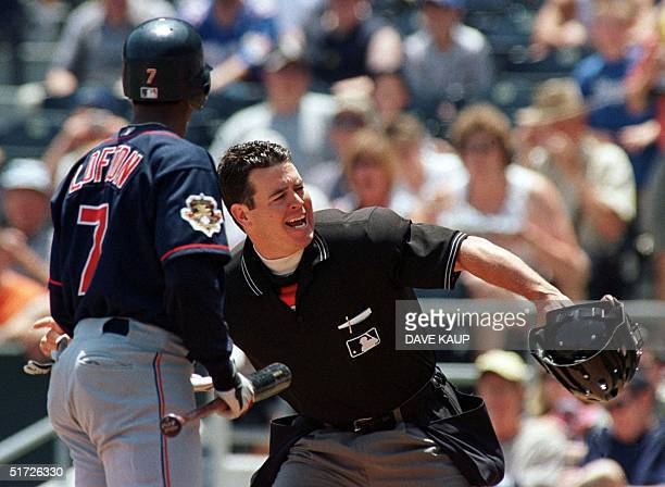 Home plate umpire Rob Drake ejects Cleveland Indians leadoff batter Kenny Lofton after the center fielder challenged a strike out from Kansas City...