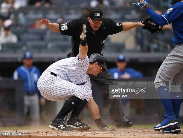 Home plate umpire Ron Kulpa declares DJ LeMahieu of the New York Yankees safe at home during the first inning of the game against the Kansas City...