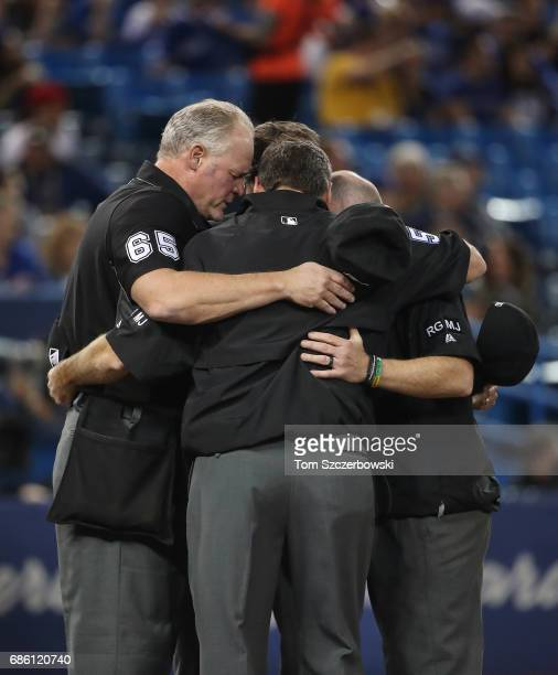 Home plate umpire Ted Barrett and first base umpire Angel Hernandez and third base umpire John Tumpane and second base umpire Lance Barksdale...