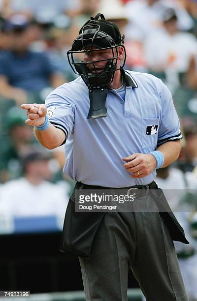 Home plate umpire Ted Barrett calls a strike during the Colorado Rockies game against the Tampa Bay Devil Rays at Coors Field on June 17, 2007 in...