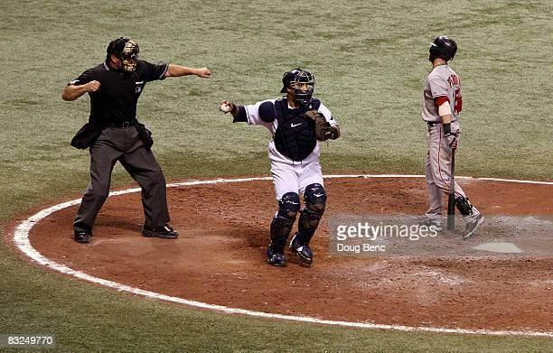 Home plate umpire Tim McClelland calls the third strike on Dustin Pedroia of the Boston Red Sox in the tenth inning of game two of the American...