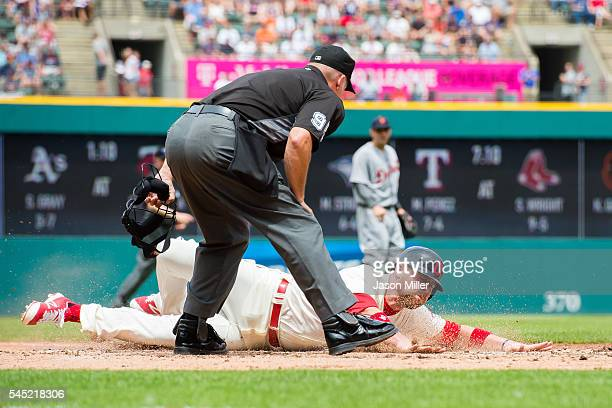 Home plate umpire Tim Timmons watches Chris Gimenez of the Cleveland Indians scores on a sacrifice fly by Francisco Lindor of the Cleveland Indians...