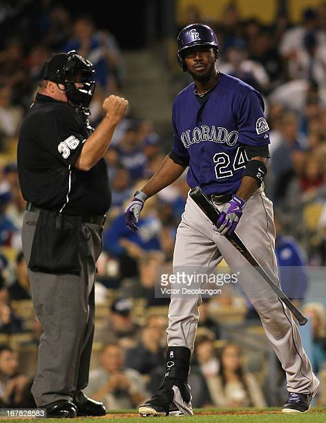 Home plate umpire Wally Bell calls the third strike on Dexter Fowler of the Colorado Rockies as Fowler looks on after striking out in the seventh...