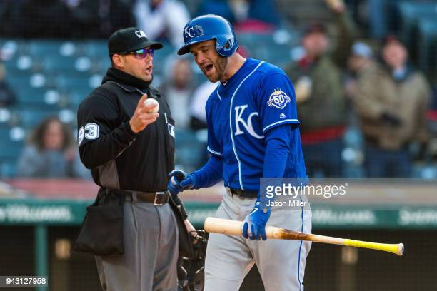 Home plate umpire Will Little listens to Drew Butera of the Kansas City Royals complain after he struck out looking to end the top of the fifth...